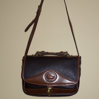 Dooney and Bourke Vintage black pebbled leather handbag shoulder bag. All weather leather.