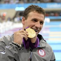 Olympic Swimmer Ryan Lochte Bites the Gold Poster 20x30 Photo