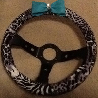 Gray cheetah print steering wheel cover with blue bow